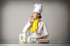 Cook tasting food Royalty Free Stock Image