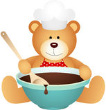 Cook teddy bear with bowl of chocolate Stock Photo