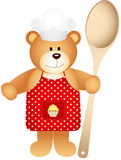 Cook teddy bear with wooden spoon Stock Photos