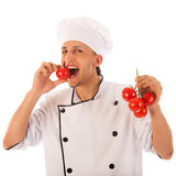 Cook testing fresh tomatoes Stock Photo