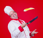Cook throw a fried egg Royalty Free Stock Images