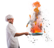 Cook troublemaker. Bumbling chef holds a pan on fire Stock Photo