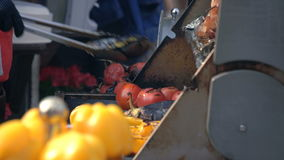 Cook Turning Vegetables On The Grill stock footage