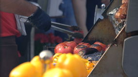 Cook Turning Vegetables On The Grill stock video footage