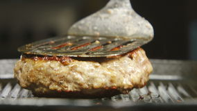 A cook turns over a beefsteak on grill stock video footage