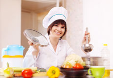 Cook in uniform cooking in kitchen Stock Photography