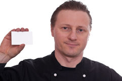 Cook is upholding a white business card Royalty Free Stock Photo