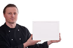 Cook is upholding a white picture frame Royalty Free Stock Photography