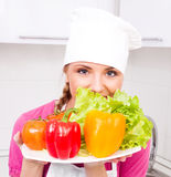 Cook with vegetables Royalty Free Stock Image