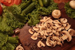 Cook  vegetables. Love to healthy eating concept. Cooked  mushrooms and a salad of tomatoes, cucumbers and greens. Proper nutrition. love to healthy eating Royalty Free Stock Images