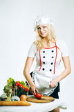 Cook with vegetables Stock Images