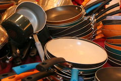 The cook ware for the party. The pots and pans are all clean and ready to cook the party delights Royalty Free Stock Image