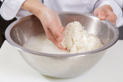 Cook washes rice Royalty Free Stock Images