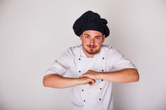 Cook on white background relies Royalty Free Stock Images