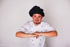 Cook on white background relies Royalty Free Stock Image