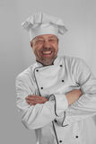 Cook in the White Cap laughs stock photography