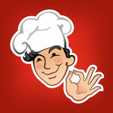 Cook in a white cap Royalty Free Stock Photo