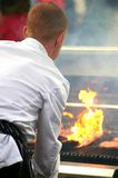 Cook in white suit. Preparing barbecue Royalty Free Stock Images