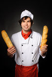 Cook wit loafs Stock Photography