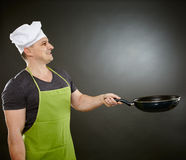 Cook with wok Stock Photos