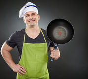 Cook with wok Royalty Free Stock Images