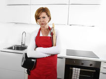 Cook woman in angry upset frustrated face expression in apron ho Stock Image
