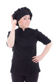 Cook woman in black uniform pointing finger up isolated on white Royalty Free Stock Photography