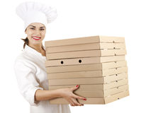 Cook woman with boxes of pizza Stock Photo
