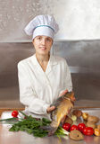 Cook woman  cooking fish Stock Photo