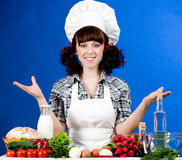 Cook woman with food ingredients Stock Image