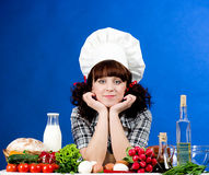 Cook woman with food ingredients Stock Photography