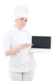 Cook woman holding laptop with copyspace isolated on white Royalty Free Stock Image
