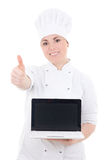 Cook woman holding laptop with empty screen and thumbs up isolated on white. Background stock photography