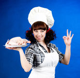 cook woman holds a Crude hen Stock Photography