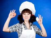 Cook woman holds a easter eggs Stock Image