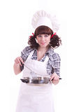 Cook woman holds a frying pan Stock Photo