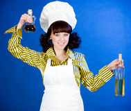 cook woman holds a oils Stock Image