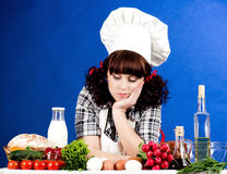 Cook woman holds Stock Photography