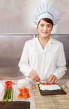 Cook woman making   sushi rolls Royalty Free Stock Photo