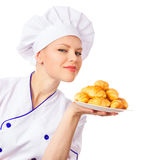 Cook woman with pastries Stock Images