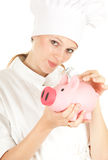 Cook woman with piggy bank Stock Photography