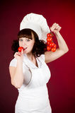Cook woman with red tomato Royalty Free Stock Photos