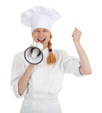 Cook woman shouting through megaphone Stock Images