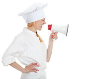 Cook woman shouting through megaphone Royalty Free Stock Photography