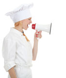 Cook woman shouting through megaphone Stock Photo