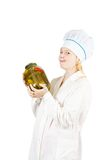 Cook woman with tin of pickled products Stock Image