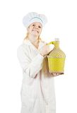 Cook woman in toque with bottle Stock Photos