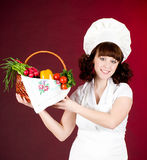 Cook woman with vegetables Royalty Free Stock Images