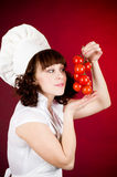Cook woman with vegetables Stock Photo