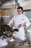 Cook at work Stock Photos